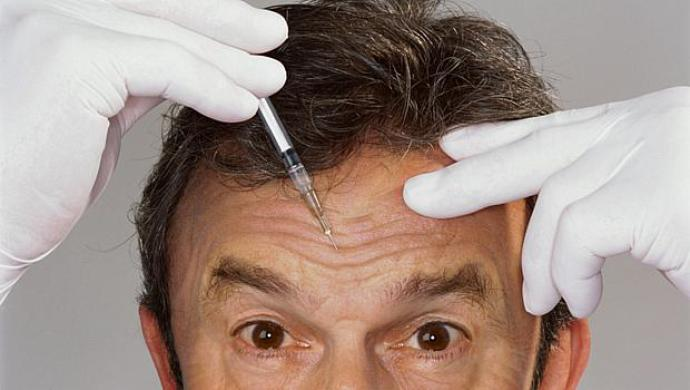 close up view of a man received a botox injection